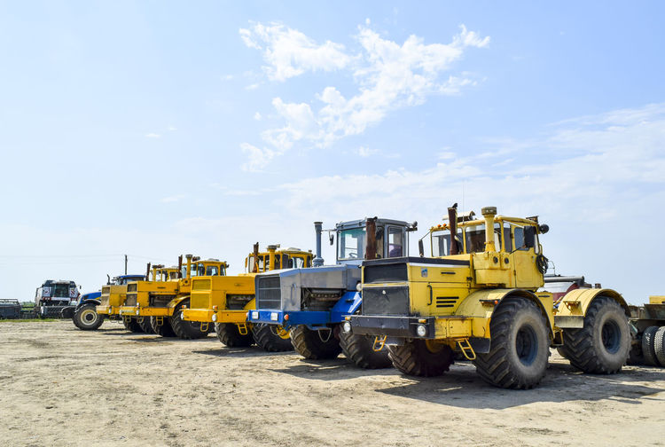 Earth movers against sky