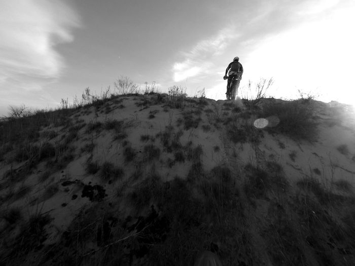 Low angle view of person on landscape against sky