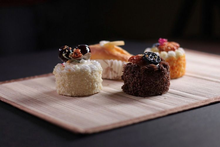 Close-up of desserts on place mat at table