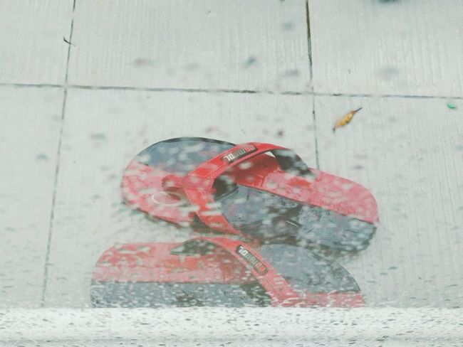 Red slippers in raining day Slippers Relaxing Redshoes Rainy Days Glass - Material Outofwindow The Still Life Photographer - 2018 EyeEm Awards Red Close-up The Street Photographer - 2018 EyeEm Awards Summer Road Tripping