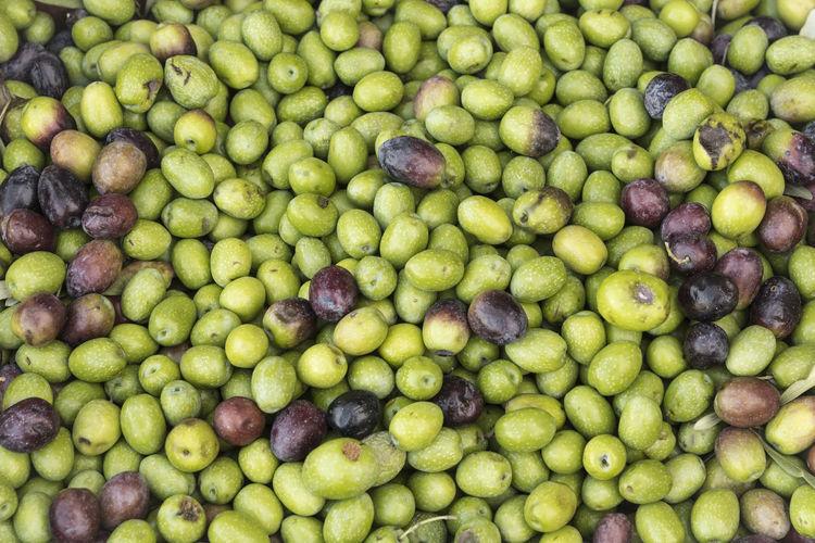 Full frame shot of green olives for sale at market
