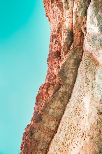 Oman Chapters Rock Rock Formation Rock - Object Clear Sky Sky Nature Beauty In Nature Solid Mountain No People Low Angle View Day Scenics - Nature Tranquility Geology Non-urban Scene Tranquil Scene Outdoors Physical Geography Land Formation Eroded Mountain Peak Arid Climate