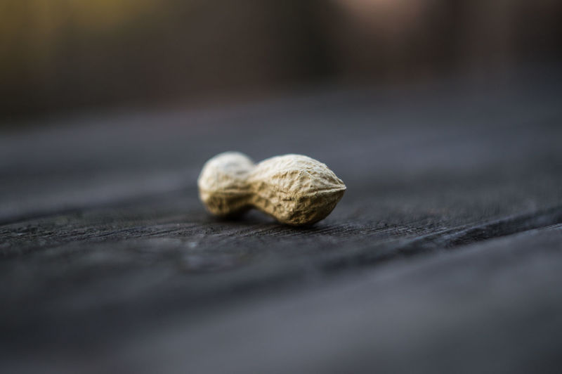 Close-up of peanut on wooden table