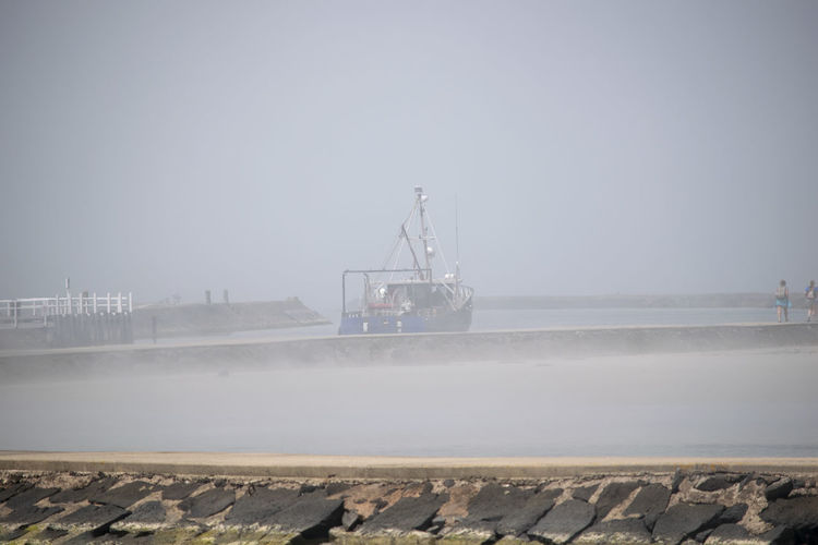 Early morning fog at Port Fairy, Victoria. Foggy Weather Going To Work Moving Boat Distant Early Morning Environment Fishing Boat Fog Foggy Foggy Day Foggy Morning Industry Leaving Mist Misty Morning Motion Nature Nautical Vessel Outdoors Sailing Sea Sky Transportation Water