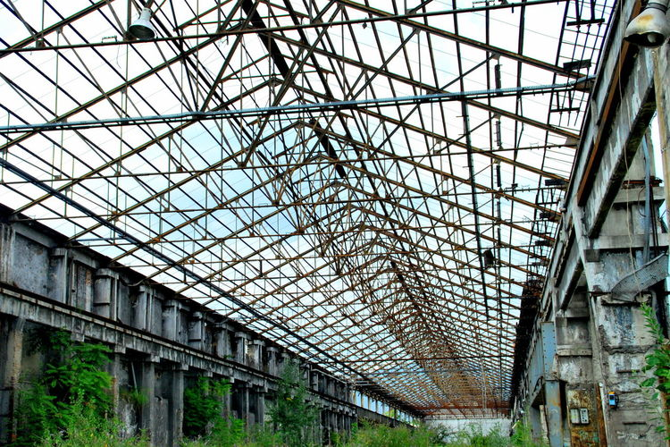 Abandoned Places Iron Roof Abandoned Abandoned Buildings Architecture Built Structure Culumns Day Greenhouse Indoors  Low Angle View No People Roof Structure
