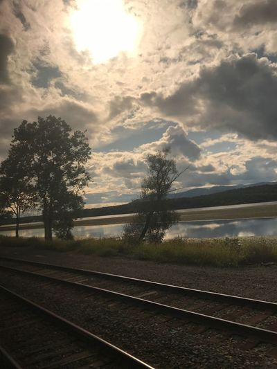 Water, clouds, tracks, train, Hudson River, water Tree landscapes Tranquil Scene Sky Outdoors Cloud - Sky Water Mountain Tranquility Beauty In Nature Connected By Travel Lost In The Landscape Connected By Travel