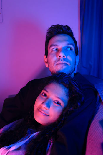 Portrait Of Smiling Girlfriend With Boyfriend At Home