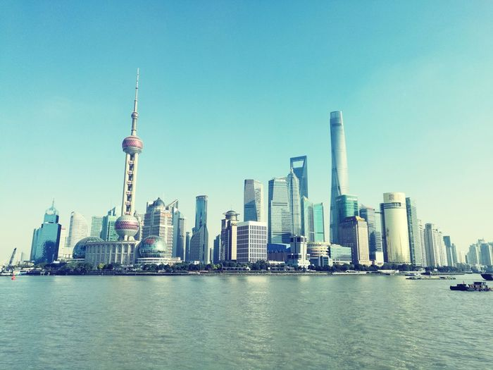Skyscraper City Sea Urban Skyline Modern Panoramic Water Sky Travel Destinations Architecture No People Outdoors Harbor Cityscape Clear Sky Nautical Vessel Building Exterior Nature Day Skyline Shanghai Pudong Skyline China