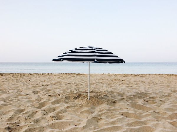 Alone Notourists Offseason Summer Umbrella Sea Beach Sand Horizon Over Water Water Tranquility Nature Beauty In Nature Tranquil Scene