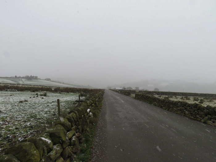 Road Shades Of Winter Wall Beauty In Nature Cold Temperature Day Field Fields Fog Grass Hills And Valleys Landscape Mist Nature No People Outdoors Road Rural Scene Scenics Sky Snow Snowing The Way Forward Tranquility Water