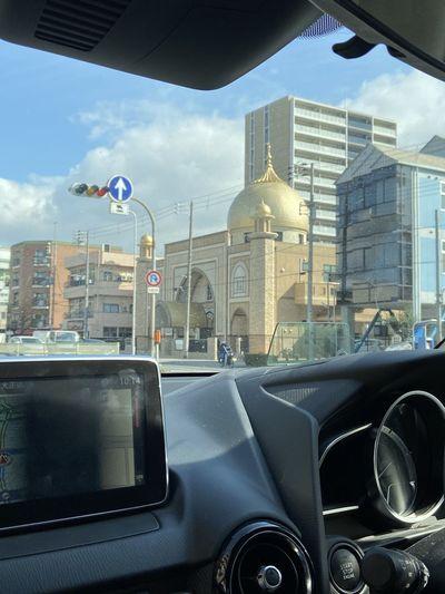 View of cars on street seen through car window