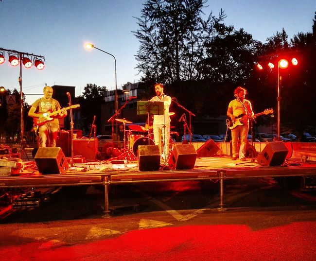 Musician Music Festival Rock Band Crepuscular Light Limelight Luci Della Sera Palco Sunset Tramonto Taking Photos Enjoying Life City Life Street Photography Fotografiadistrada Night Photography Night Lights Nightlife Guitarist Batterista Drummer Chitarra Chitarrista
