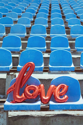 Love text on chair at stadium