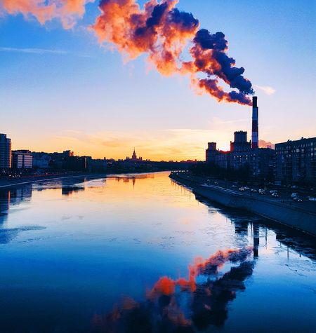 Winter sunset in Moscow Colour Your Horizn Sunset City Water River Reflection EyeEm Best Shots Sunset_collection Moscow Russia EyeEm Selects Architecture Factory Built Structure City Nature Day Cityscape Urban Skyline No People Outdoors Building Exterior
