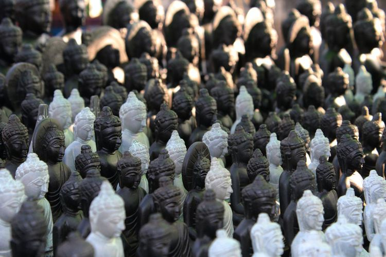 Small statues of Lord Buddha Food And Drink Art And Craft Retail Display Side By Side Market Repetition Backgrounds Arrangement Still Life No People Order For Sale Retail  Selective Focus Abundance Full Frame In A Row Large Group Of Objects Buddha Statues Buddha Close-up