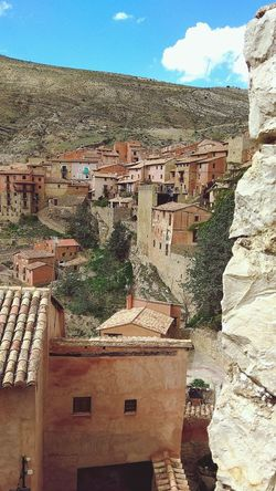"Old Spanish mountain town Albarracín"" Stone Houses  Stone Material Mountain Town Tourist Attraction  Historic Heritage Hanging Houses Albarracín Spain Water Sunlight Sky Rocky Mountains Ancient Civilization"