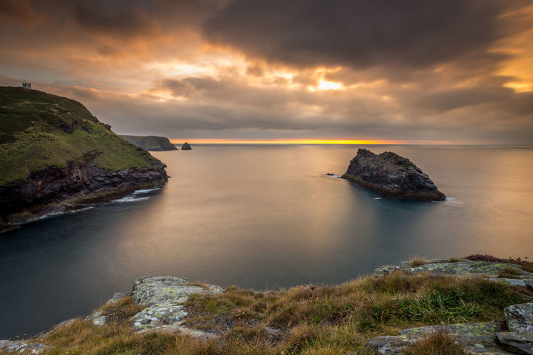 Sun working its magic in the sky over the sea at Boscastle North Cornwall England Beauty In Nature Boscastle Cloud - Sky Cornwall Day Harbour Horizon Over Water Idyllic Nature No People Outdoors Rock - Object Scenics Sea Sky Sunset Tranquil Scene Tranquility Water