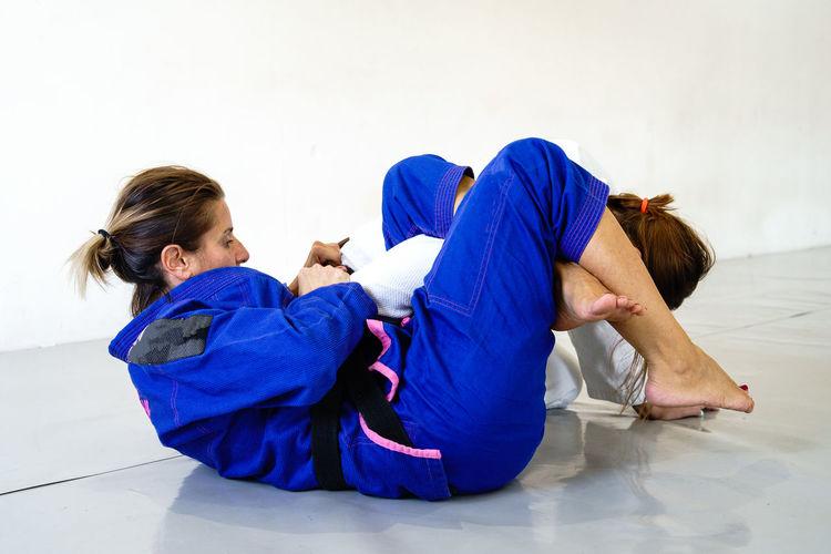 Women lying down on floor