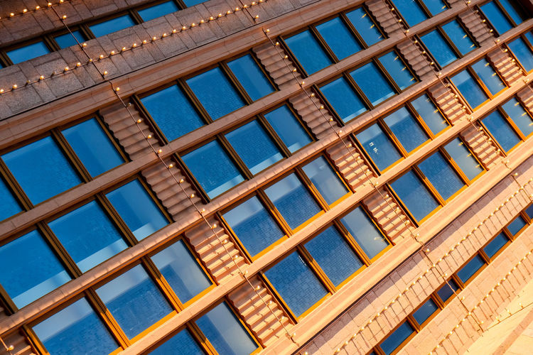 Modern office building, detailed view of finance house windows. pattern. office building, blue glass
