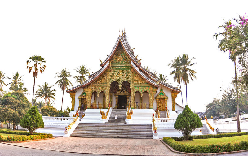 the temple in loas Architecture Belief Building Building Exterior Built Structure Clear Sky Day Nature No People Ornate Outdoors Palm Tree Place Of Worship Plant Religion Shrine Sky Spirituality Tree Tropical Climate