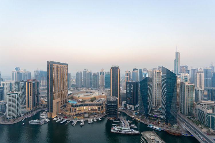 Panoramic view of buildings in city against sky. dubai marina. uae