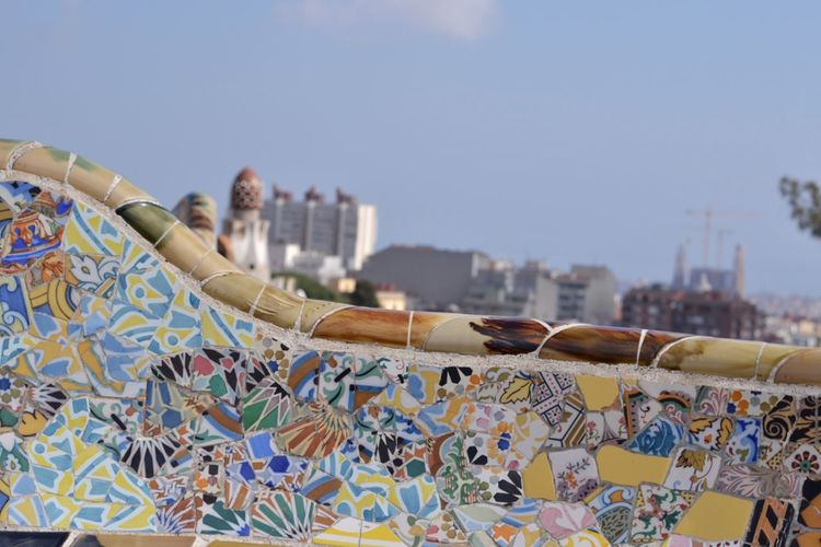 Close-up of mosaic on wall against sky