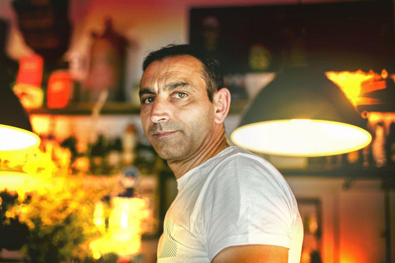 Portrait Of Mature Man By Illuminated Lighting Equipment