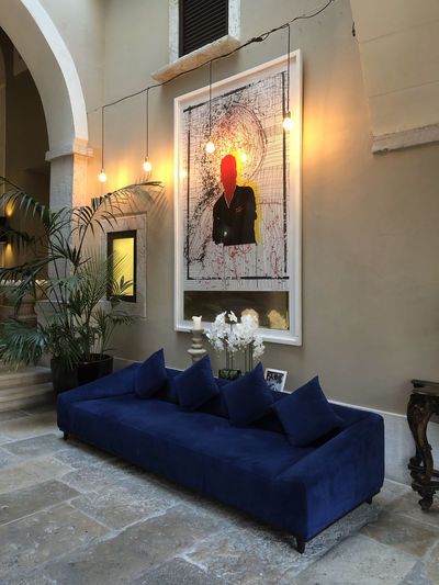 Boutique hotel lobby in Lisbon, Portugal Lisbon Portugal Architecture Built Structure Indoors  No People Lighting Equipment Luxury Boutique Hotel Lobby Illuminated Plant Sofa Home Interior Building Living Room Furniture Domestic Room Flooring Decoration Window Glass - Material Pillow
