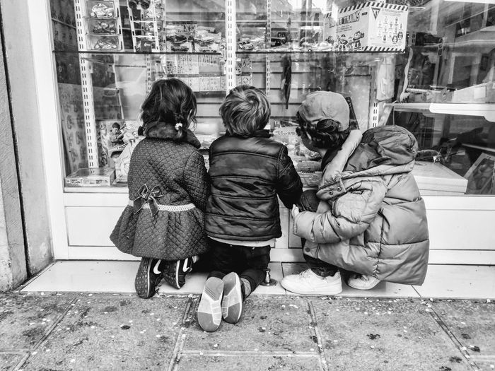 Wishlist The Art Of Street Photography Rear View Real People Lifestyles Child Architecture Day People City Togetherness Full Length Childhood Group Of People Casual Clothing Built Structure Sitting Window Social Issues Warm Clothing Exploring Fun The Street Photographer - 2019 EyeEm Awards