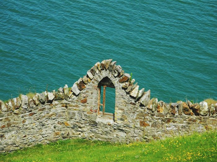 EyeEm Selects Water Day Sea Built Structure High Angle View Nature No People Architecture Outdoors Textured  Grass Building Exterior (c) 2017 Shangita Bose All Rights Reserved Dublin, Ireland Howt Harbor Window Scenics Wall Lost In The Landscape