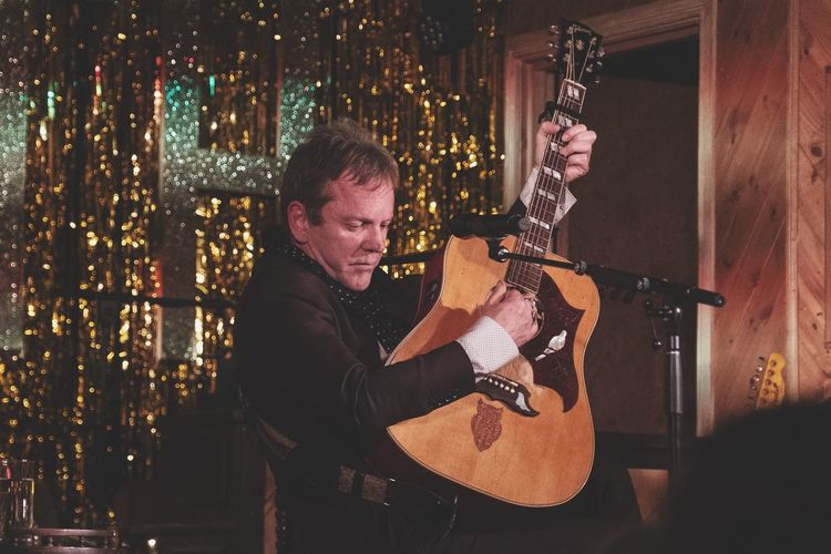 Kiefer Sutherland live in London One Person Indoors  Music Night Real People Sitting Arts Culture And Entertainment