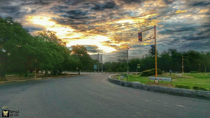 Dramatic sky... Cloud - Sky Sunset Sky Tree Street Light Road No People Outdoors Transportation Stoplight City Road Sign Grass Day Nature Travelphotography Sunrise_Collection Cloudscape Beauty In Nature Nature Dramatic Sky Cycletour Traveldiaries High Angle View Epic