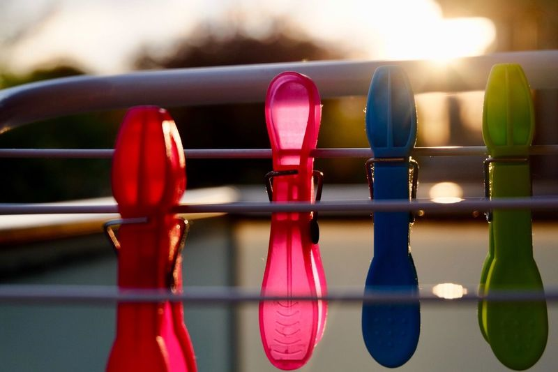 Fujifilm_xseries Close-up No People Day Focus On Foreground Multi Colored Pink Color Sunlight Clothespin Reflection Selective Focus Metal Nature Clothesline Safety Hanging Outdoors Still Life Representation Red Inflatable