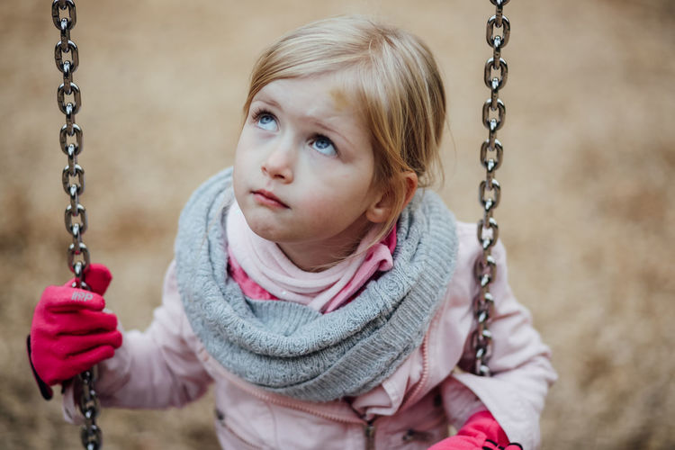 High angle view of girl on swing at park