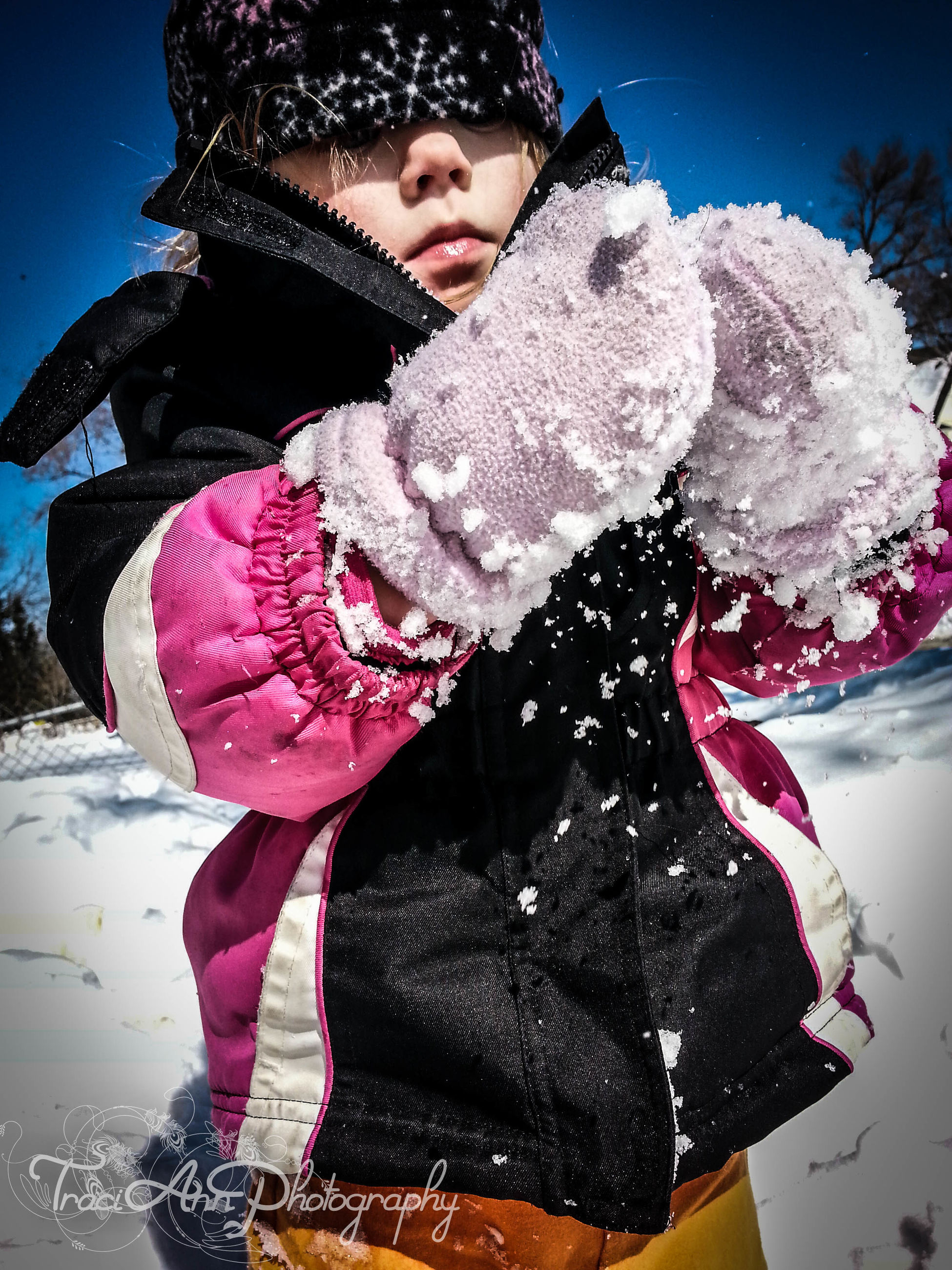 winter, snow, cold temperature, season, person, lifestyles, front view, full length, leisure activity, warm clothing, casual clothing, looking at camera, weather, standing, holding, portrait, young adult, three quarter length