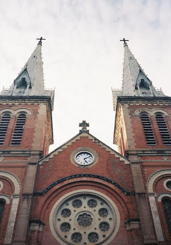 ting tong Film 35mm Konica Clock City Clock Face Place Of Worship Spirituality Religion History Rose Window Architecture Building Exterior