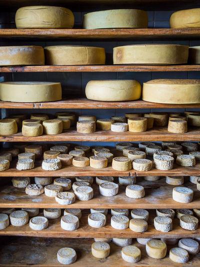 Full Frame Shot Of Handmade Organic Cheese Aging On Shelf