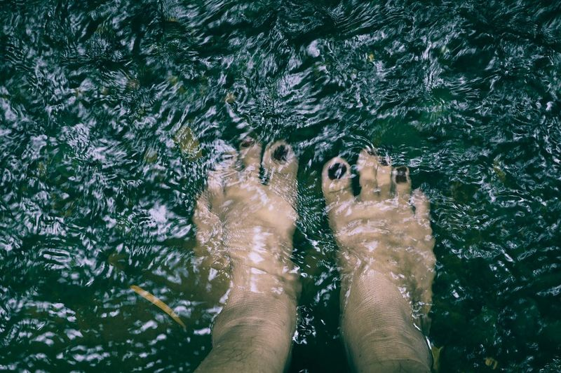 Low Section Human Leg Human Body Part Personal Perspective Body Part Real People One Person Lifestyles Limb Adult Nature barefoot Water Women Human Limb Human Foot Leisure Activity Day Directly Above Outdoors