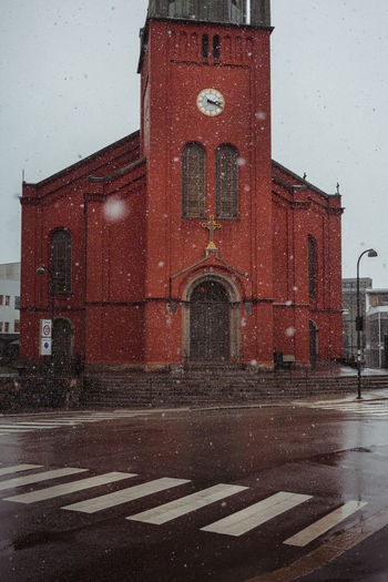 Church Red Stavanger Architecture Building Exterior Built Structure City Cold Temperature Curch Day No People Outdoors Red Red Church Road Sign Sky Snow Snowing St Petri Kirke Weather Winter