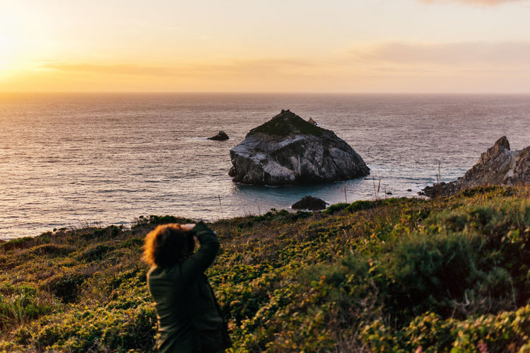 Adult Beach Beauty In Nature Big Sur California Cliff Day Horizon Over Water Leisure Activity Nature One Person Outdoors Pacific Ocean Photographing Photography Themes Real People Rock - Object Sea Sky Standing Sunset Tranquility Water West Coast Women