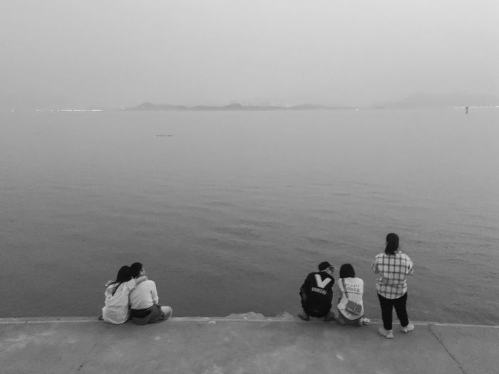 Shenzhen, China 2019 Blackandwhite Street Of China Streetphotography Iphone6s VSCO IPhoneography Mobilephotography Water Group Of People Beach Sitting Sea Childhood Day Real People People Outdoors High Angle View Boys Girls