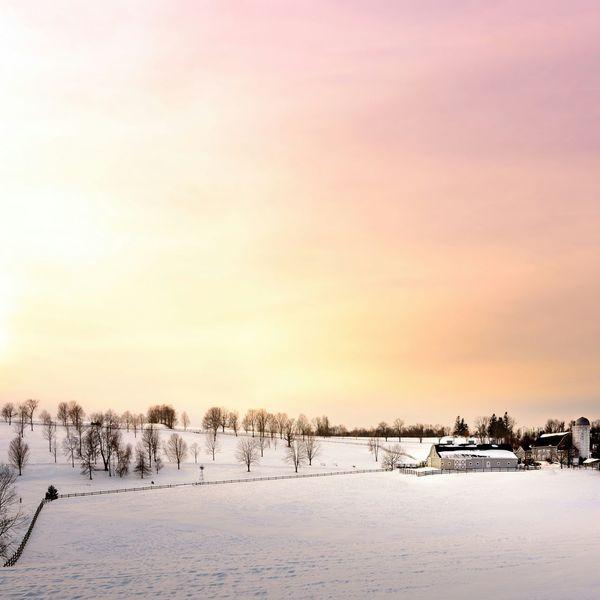 Sunset over some Farmhouse Barn in Litchfield. Winter Wonderland Winter Snowscape
