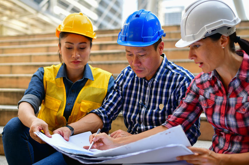 Adult Analyzing ARCHITECT Architecture Asian  Background Blueprint Build Builder Business Businessman Businesspeople City Communication Construct Construction Cooperation Create Creator  Design Designer  Engineer Engineering Explaining  Female Hand Handshake Happiness Happy Helmet Industry Instrument Male Man Meeting Plan Planner Present Presentation Professional Project Shake Smiling Success Successful Talking Team Teamwork Woman Work