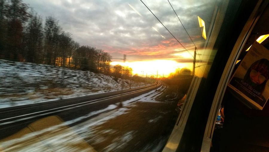 SBB Sunrise Public Transportation Commuting Tree City Sunset Winter Road Cold Temperature Rail Transportation Railroad Track Train - Vehicle Land Vehicle Passenger Train Train Railway Track