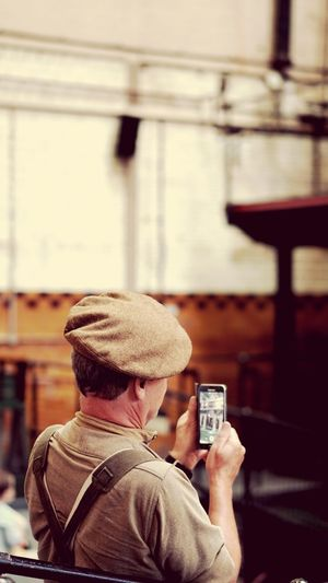 Kelham Island Museum Looking At The Phone Smart Phone On The Phone... Military Dress Uniform Military Costume Army Military Uniform World War 2 Memorial 1940s Style Fashion 1940's Weekend 1940's Army Soldier Sheffield Kelham Island Smart Phone Technology Wireless Technology Mobile Phone Portable Information Device Hat Communication
