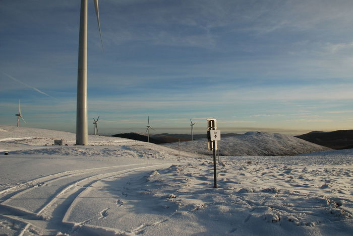 Freezing Cold Green Knowls Windfarm Wind Generators Wind Turbine Wintertime Beauty In Nature Cold Temperature Day Exit Sign Landscape Nature No People Outdoors Renewable Energy Scenics Sky Snow Snowcapped Mountain Tranquil Scene Tranquility Weather Winter