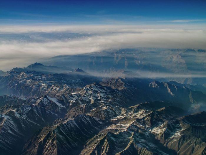 High angle shot of rocky landscape against sky