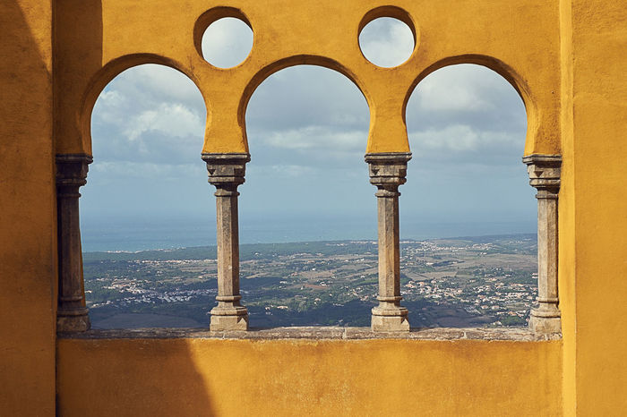 Pena palace Built Structure Architecture Arch Day No People Nature Sky Window Building Exterior Cloud - Sky Architectural Column History Outdoors Building Travel Destinations Wall - Building Feature Mountain Sea