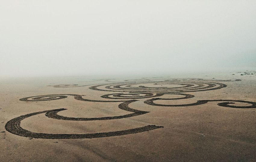 Today on the beach... It was very foggy but beautiful and mysterious. We came across a man with a rake creating sand art. I love it! Sand Fog Artistic Expression AndroidPhotography ToolWiz Photos Photo Editor My Photo Album ♡