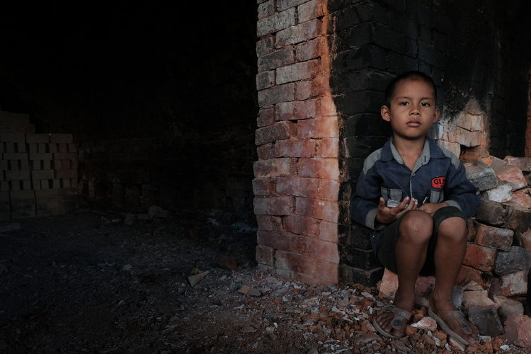 Portrait Of Boy At Abandoned Building